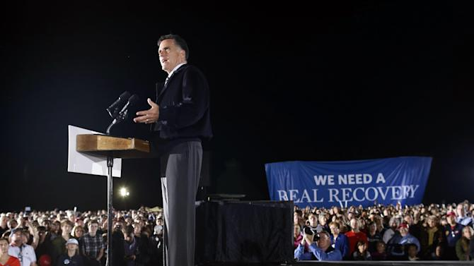 FILE - In this Oct. 17, 2012 file photo, Republican presidential candidate and former Massachusetts Gov. Mitt Romney campaigns at Ida Lee Park in Leesburg, Va. Independent groups working to elect Republican Mitt Romney have helped him match or even exceed President Barack Obama's TV ad spending in dozens of media markets in battleground states. But the spending disparity doesn't tell the whole story, as Obama is still getting more value for his money with his ads.  (AP Photo/Charles Dharapak)