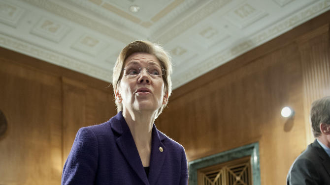 Sen. Elizabeth Warren, D-Mass., questions a witness after the conclusion of a Senate Banking Committee hearing on anti-money laundering on Capitol Hill in Washington, Thursday, March 7, 2013. Warren rose to national prominence as an outspoken consumer advocate decrying Wall Street abuses and became the progressive movement's darling candidate in last fall's Senate elections. Like most freshman lawmakers, the Massachusetts Democrat has maintained a low profile during her first few months in office, but that's starting to change. (AP Photo/Cliff Owen)