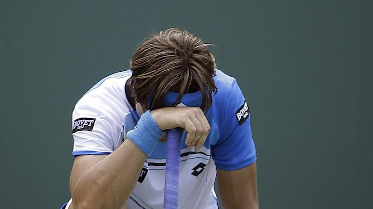 David Ferrer, of Spain, reacts after losing to Andy Murray of Britain during the Sony Open Tennis Tournament in Key Biscayne, Fla., Sunday, March 31, 2013. Murray won 2-6, 6-4, 7-6 (1). (AP Photo/J Pat Carter)