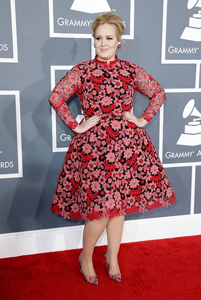 BEST: Adele wearing Valentino  Adele wore color! Spring 2013 Valentino Couture RED, to be exact. She shortened it to the knee from the runway gown-length original, and we love the way it looks. The vi
