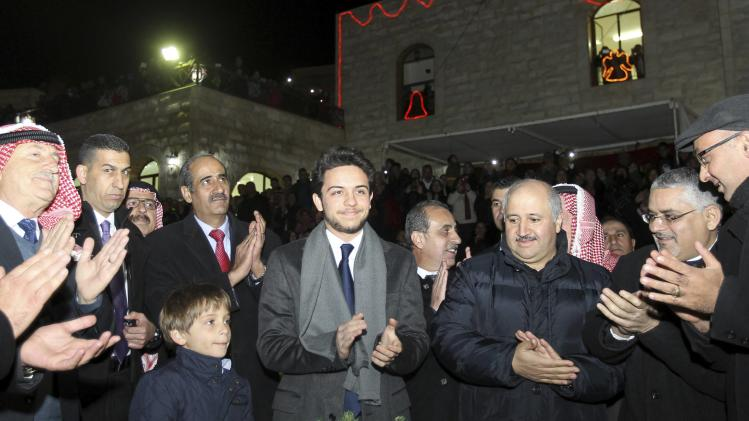 Jordan's Crown Prince Hussein bin Abdullah and his brother Prince Hashem participate in a celebration of a Christmas tree lighting in the mostly Christian town of Al-Fuheis
