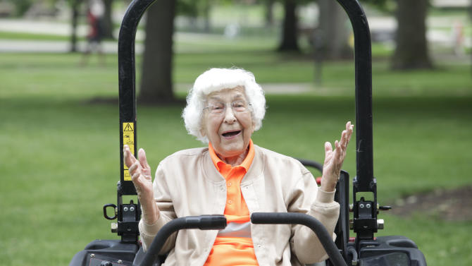 Trudy Price, who turned 100 on Monday, reacts while sitting on a riding lawn mower, Monday, June 9, 2014, on the campus of Bowling Green State University in Bowling Green, Ohio. Brookdale Senior Living and Wish of a Lifetime formed a partnership to provide a helping hand in making Price's dream of mowing a lawn and planting flowers come true. (AP Photo/Sentinel-Tribune, J.D. Pooley) MANDATORY CREDIT, TOLEDO BLADE OUT