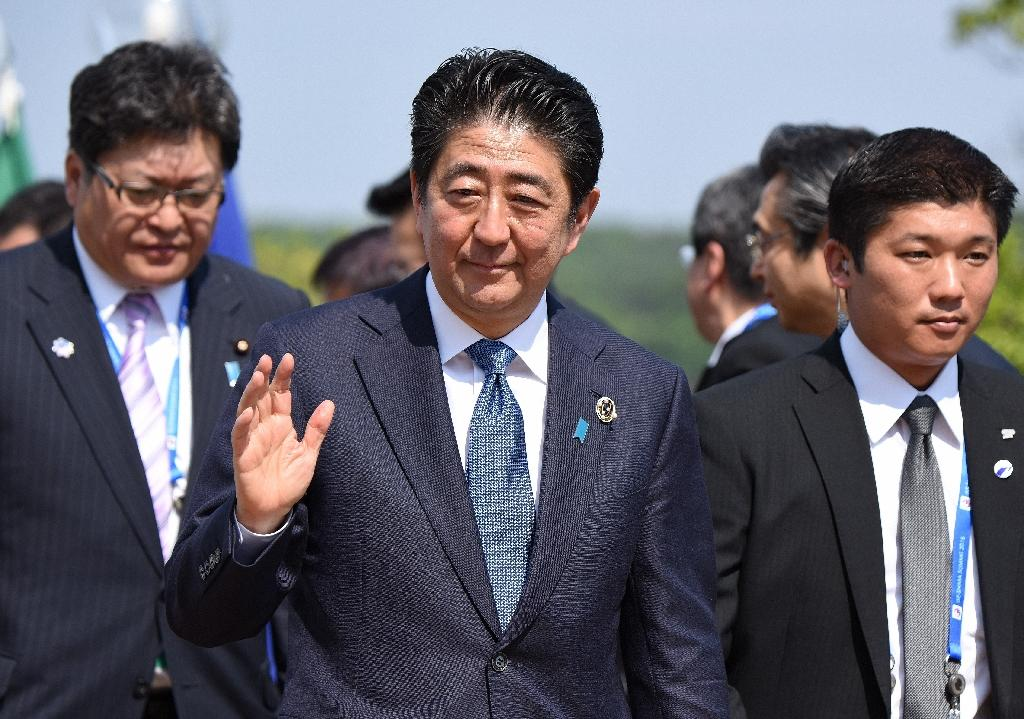 Japan's Abe may leave tax hike to next PM: reports