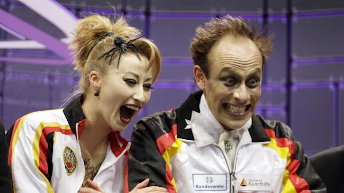 AP10ThingsToSee - Nelli Zhiganshina and Alexander Gazsi, of Germany, react to their scores after the free skate program in the ice dancing competition at the World Figure Skating Championships on Saturday, March 16, 2013, in London, Ontario. (AP Photo/Darron Cummings, File)