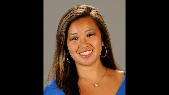 This undated file photo provided by Cal State Fullerton on Monday, Feb. 4, 2013, shows Cal State Fullerton assistant women's NCAA college basketball coach Monica Quan in Fullerton, Calif. Quan and her fiance Keith Lawrence were found shot to death Sunday night on the top floor of a parking structure at the complex, police said. Former LAPD officer and U.S. Navy reservist Christopher Jordan Dorner, 33, is a suspect in the killings. (AP Photo/Cal State Fullerton, File)