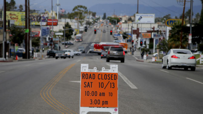 A sign advising the street closure is seen on Crenshaw Boulevard prior to the transfer of the space shuttle Endeavour in Inglewood, Calif., Thursday, Oct. 11, 2012. Beginning Friday, the shuttle heads off on its last mission, a 12-mile creep through city streets. It will move past an eclectic mix of strip malls, mom-and-pop shops, tidy lawns and faded apartment buildings. Its final destination: California Science Center in South Los Angeles where it will be put on display. (AP Photo/Jae C. Hong)