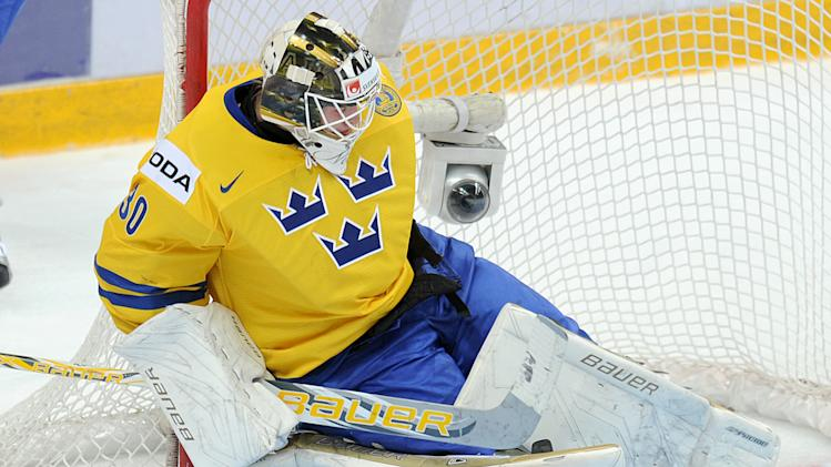 Sweden's goalkeeper Niklas Lundstrom lets in a goal by USA in a gold medal match at  the World Junior Ice Hockey championship in Ufa, Russia, Saturday, Jan. 5, 2013. (AP Photo/Yuri Kuzmin, KHL)