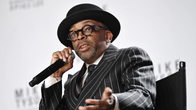 "FILE - This June 18, 2012 file photo shows director Spike Lee talks about his Broadway directorial debut ""Mike Tyson: Undisputed Truth"", a one man show starring Mike Tyson, in New York. Lee is working on a yet untitled documentary about Michael Jackson's ""Bad"" album. Lee's documentary will be part a flood of material to celebrate the 25th anniversary of the ""Bad"" album, Jackson's follow-up to ""Thriller"" which included hits like the title track, ""Smooth Criminal,"" ""The Way You Make Me Feel"" and more.  The album is being re-released Sept.18 with additional tracks, a DVD and other bonus material; Lee's film is due to come out later this year, but no date has been set.  (Photo by Evan Agostini/Invision/AP, file)"