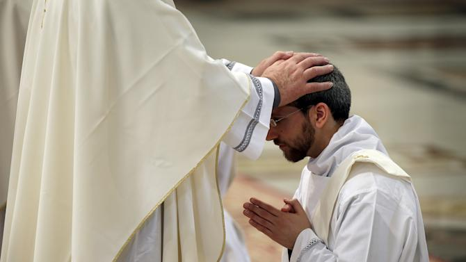 Newly ordained priest is seen as Pope Francis leads a mass to ordain 19 new priests in the St. Peter's Basilica at the Vatican