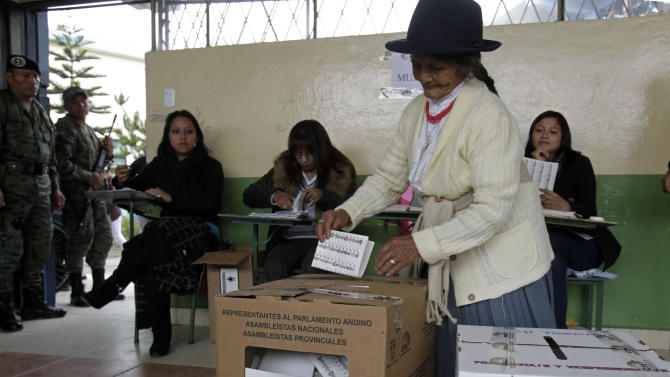 A woman casts her ballot for parliament members at a polling station in Quito, Ecuador, Sunday, Feb.17, 2013. Ecuadoreans  elect president,  vice-president and National Assembly members Sunday with President Rafael Correa highly favored to win a second re-election.(AP Photo/Dolores Ochoa)