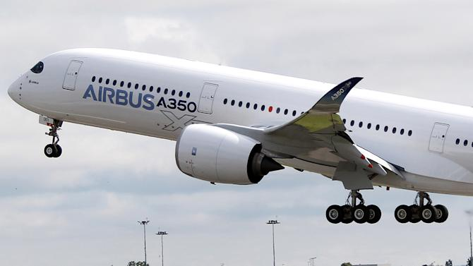 The Airbus A350 takes off on its maiden flight at Blagnac airport near Toulouse, southwestern France, Friday, June 14, 2013. The Airbus A350 has taken off on its maiden flight, setting the stage for intensifying competition with U.S. rival Boeing in the long-haul wide-body aircraft market. (AP Photo/Bob Edme)