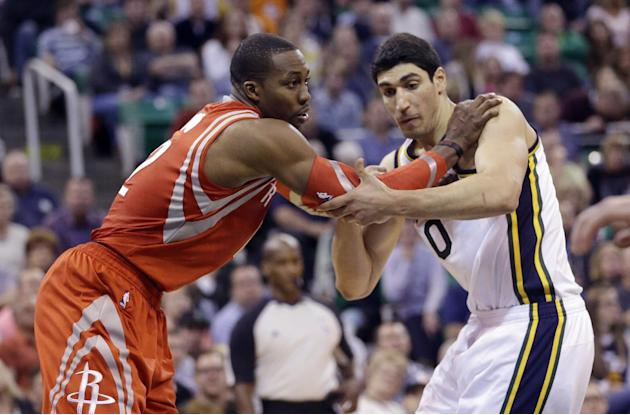 Houston Rockets' Dwight Howard, left, and Utah Jazz's Enes Kanter (0) battle for position under the boards in the second half during an NBA basketball game Saturday, Nov. 2, 2013, in Salt Lake City. T