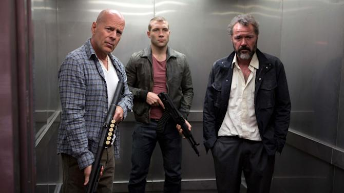 """FILE - This publicity film image released by 20th Century Fox shows Bruce Willis as John McClane, left, Jai Courtney as his son Jack, center and Sebastian Koch as Komarov in a scene from """"A Good Day to Die Hard."""" (AP Photo/20th Century Fox, Frank Masi, File)"""