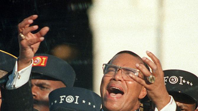 FILE - In this Monday, Oct. 16, 1995 file photo, Nation of Islam leader Louis Farrakhan addresses the Million Man March from Capitol Hill in Washington. (AP Photo/Doug Mills)