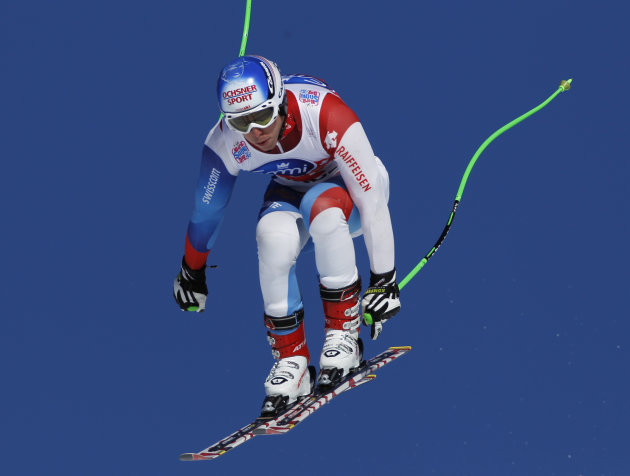 ** CORRECTS THE COUNTRY IN CAPTION ** Switzerland's Carlo Janka in action during a men's alpine skiing, World Cup downhill training session in Wengen, Switzerland, Thursday Jan. 12, 2012. (AP Photo/Ta