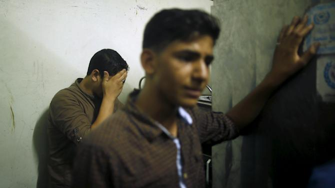Friends of Palestinian teen Al-Masri, whom medics said was shot and killed by Israeli forces, mourn at hospital morgue in northern Gaza Strip