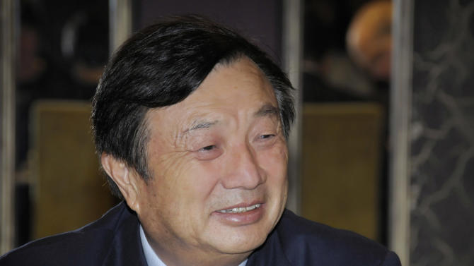 In this photo released by Huawei Technologies Co., Ren Zhengfei, CEO and founder of Huawei based in Shenzhen, China, smiles during his meeting with local media Thursday, May 9, 2013 in Wellington, New Zealand. Ren said the company is committed to bringing value and contributing to New Zealand's digital economy. (AP Photo/Huawei Technologies Co.)