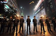 Chinese police standing guard in Chongqing. A Chinese official sentenced without trial to hard labour for opposing the Maoist revival policies of disgraced politician Bo Xilai has been freed and is seeking compensation, his lawyer has told AFP