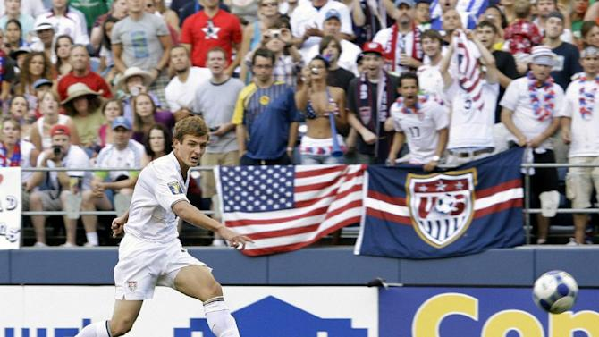 FILE - In July 4, 2009 file photo, United States' Robbie Rogers kicks against Grenada in a CONCACAF Gold Cup match at Qwest Field in Seattle. Rogers is eligible to make his debut with the Los Angeles Galaxy after Major League Soccer said it had received his international transfer certificate. The former U.S. national team winger will become the first openly gay male athlete to compete in a North American professional team sport when he makes his debut for the Galaxy, which could come in Sunday night's, May 26, 2013, game against Seattle. (AP Photo/Ted S. Warren, File)