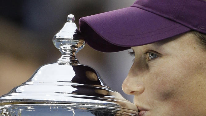 Samantha Stosur of Australia poses with the championship trophy after beating Serena Williams at the U.S. Open tennis tournament in New York, Sunday, Sept. 11, 2011. (AP Photo/Matt Slocum)