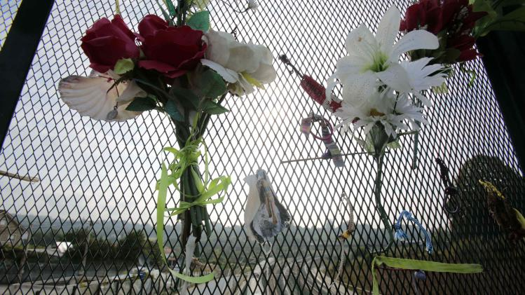 Flowers and commemorative items paying tribute to train crash victims are seen, near Santiago de Compostela