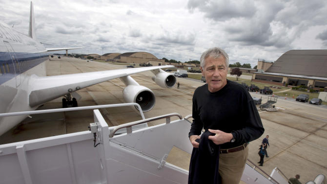 "FILE - In this Sept. 28, 2013, file photo U.S. Secretary of Defense Chuck Hagel boards his plane at Andrews Air Force Base, Md., en route to South Korea. Saturday, Oct. 5, 2013, the Pentagon ordered most of its approximately 400,000 furloughed civilian employees back to work. The decision by Hagel is based on a Pentagon legal interpretation of a law called the Pay Our Military Act. That measure was passed by Congress and signed by President Barack Obama shortly before the partial government shutdown began Tuesday, Oct. 1. The Pentagon did not immediately say on Saturday exactly how many workers will return to work, but use the term ""most"". (AP Photo/Jacquelyn Martin, File)"