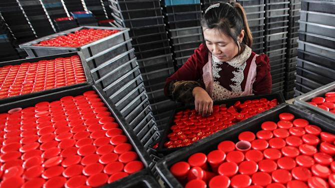 China's overall economy expanded 7.4% in 2014, a 24-year low, with the slowdown prompting authorities to loosen monetary policy in a bid to put a floor under growth