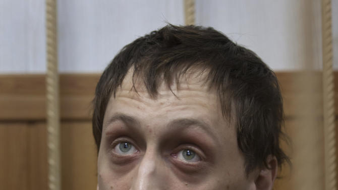 """Bolshoi soloist Pavel Dmitrichenko listens in a courtroom in Moscow, Russia, Thursday, March 7, 2013. The star dancer accused of masterminding the attack on the Bolshoi ballet chief acknowledged Thursday that he gave the go-ahead for the attack, but said he did not order anyone to throw acid on the artistic director's face. Dmitrichenko told a Moscow court that he had complained about ballet chief Sergei Filin to an acquaintance, who offered to """"beat him up."""" (AP Photo/Alexander Zemlianichenko)"""