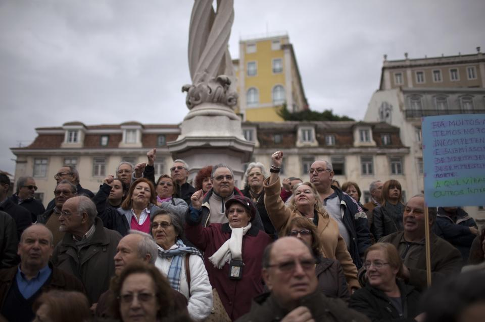 Demonstrators react during speeches at the end of an anti-austerity protest march in Lisbon Saturday, Feb. 16 2013. The protest was called by CGTP, the Portuguese confederation of workers unions. (AP Photo/Armando Franca)