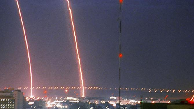 FILE - This Jan. 26, 1991 file photo shows dual U.S. Patriot missiles lighting up the skyline of the Saudi Arabia capital city of Riyadh, as Iraq continued attacking with its Scud-B missiles. One Patriot apparently intercepted the inbound Scud and disabled it. President Barack Obama is poised to become the first U.S. leader in three decades to attack a foreign nation without broad international support or in direct defense of Americans. Not since President Ronald Reagan ordered an invasion of the Caribbean island of Grenada in 1983 has the U.S. been so alone in pursuing major lethal military action beyond a few attacks responding to strikes or threats against its citizens. (AP Photo/John Gaps III, File)