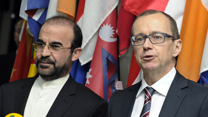 """Iran's Ambassador to the International Atomic Energy Agency, IAEA, Reza Najafi, left, and IAEA Deputy Director General and Head of the Department of Safeguards Tero Tapio Varjoranta, right, deliver a statement after their meeting at the International Center in Vienna, Austria on Tuesday, Oct. 29, 2013. Talks between Iran and the U.N. atomic agency have gone into a second day after a senior Iranian envoy offered a """"new approach"""" meant to end the deadlock over terms of a U.N. probe of suspicions Tehran worked on nuclear arms. (AP Photo/Hans Punz)"""