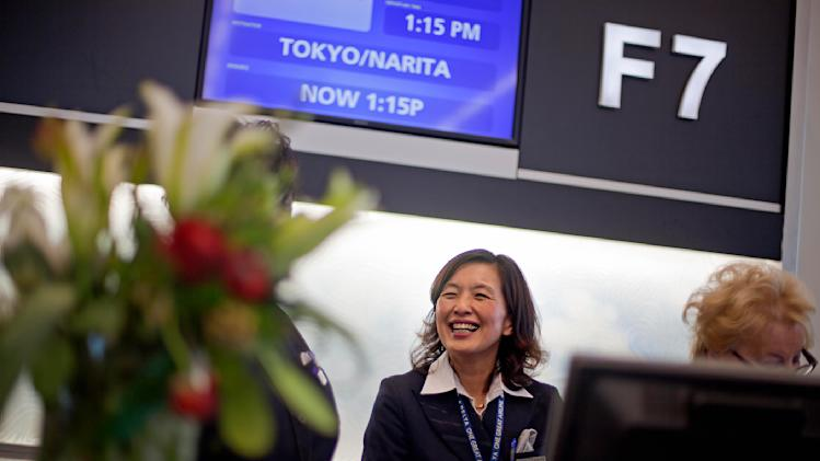 Gate agent Ayumi Buttrill, waits to board passengers on a plane to Tokyo, the first flight to leave out of the the new Maynard Holbrook Jackson Jr. International Terminal at Atlanta's airport on the first day it begins operating flights Wednesday, May 16, 2012, in Atlanta. (AP Photo/David Goldman)