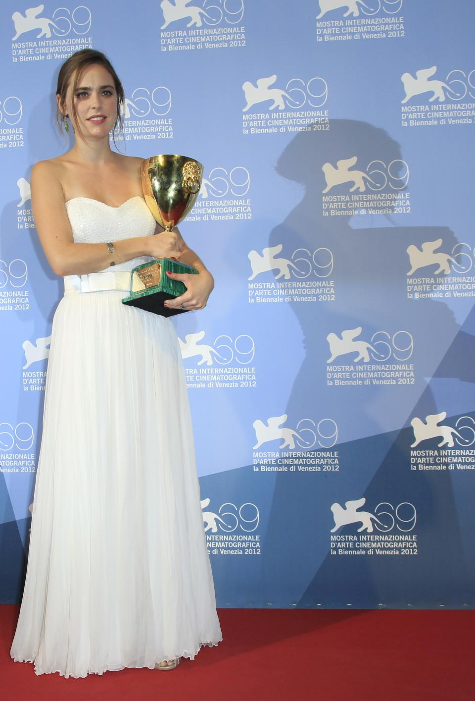 Actress Hadas Yaron poses with the Coppa Volpi for best actress for her role in the movie 'Lemale Et Ha'Chalal' at the awards photo call during the 69th edition of the Venice Film Festival in Venice, Italy, Saturday, Sept. 8, 2012. (AP Photo/Joel Ryan)
