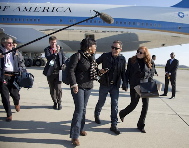 Bruce Springsteen and his wife wife Patti Scialfa are followed by press pool media members as they deplane off the back of Air Force One at Rickenbacker International Airport in Columbus, Ohio, Monday, Nov. 5, 2012, as they traveled with President Barack Obama to a campaign event at Nationwide Arena. (AP Photo/Carolyn Kaster)