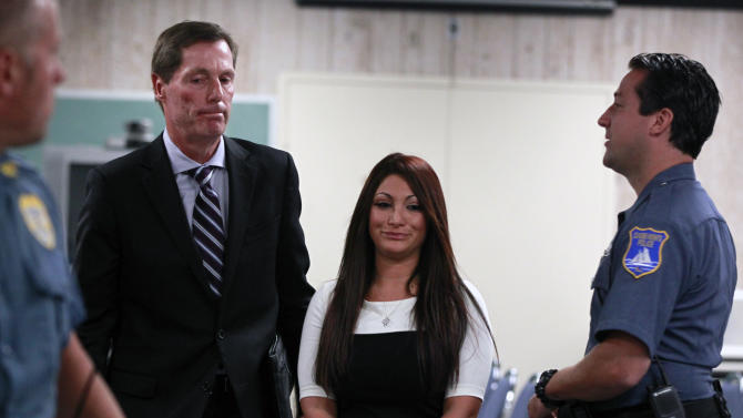 """Jersey Shore"" cast member Deena Cortese, center, walks with her attorney Michael Pappa, left, in court after a hearing Tuesday, July, 3, 2012, in Seaside Heights, N.J. The ""Jersey Shore"" cast member was in Seaside Heights municipal court on a change of interfering with traffic for an incident in which police say she was dancing in a street and blocking the flow of traffic. Cortese pleaded guilty to failing to use the sidewalk and paid a $106 fine.(AP Photo/Mel Evans)"