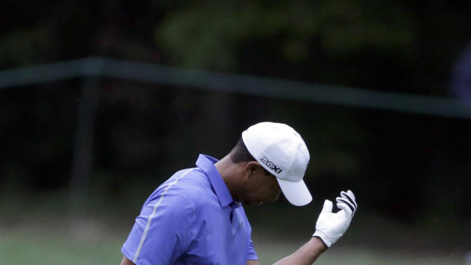 Tiger Woods looks at his hand after a shot on the 11th hole during the first round of the U.S. Open golf tournament at Merion Golf Club, Thursday, June 13, 2013, in Ardmore, Pa. (AP Photo/Darron Cummings)
