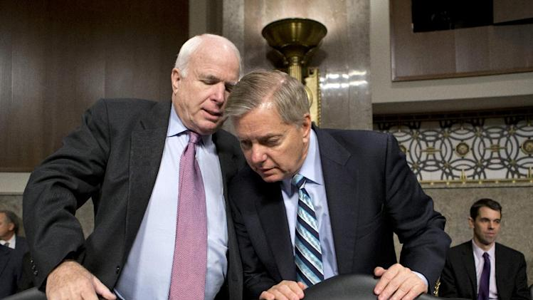 Senate Armed Services Committee members, Sen. John McCain, R-Ariz., left, and Sen. Lindsey Graham, R-S.C. confer on Capitol Hill in Washington, Thursday, Feb. 14, 2013, at the start of the committee's hearing on the appointments of military leaders. The two Republicans have been vocal in their opposition to the nomination of Chuck Hagel to be the next secretary of defense.  While Democrats hold a 55-45 edge in the Senate and have the numbers to confirm Hagel on a majority vote, they need the support of five Republicans to clear the way for an up-or-down vote on him. (AP Photo/J. Scott Applewhite, File)