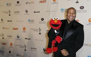 "Puppeteer Clash who is voice of ""Elmo,"" arrives for International Emmys in New York"