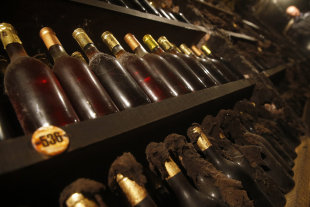 Bottles of aged wines, some of which date back to 1895, are lined up in a wine vault containing 280,000 bottles in Tokaj: Credit Reuters