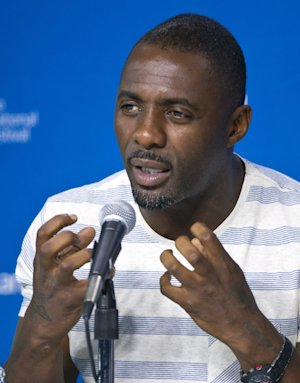 """Actor Idris Elba answers a question during the press conference for """"Mandela: Long Walk to Freedom"""" at the 2013 Toronto International Film Festival in Toronto on Sunday, Sept. 8, 2013. (AP Photo/The Canadian Press, Galit Rodan)"""