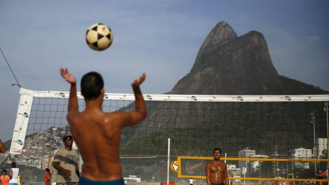Residents play footvolley, a sport that combines both soccer and volleyball, on Ipanema beach in Rio de Janeiro