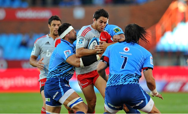 Bulls' Jacques Potgieter (R) and Wynand Olivier (L) tackle Crusaders' Sean Maitland (C) during the Super 15 Rugby Union match between Bulls and Canterbury Crusaders at Loftus Versfeld stadium in Preto