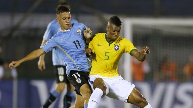 Brazil's Walace challenges Uruguay's Acosta during their South American Under-20 Championship final round soccer match in Montevideo
