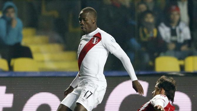 Peru's Advincula is challenged by Paraguay's Romero during their Copa America 2015 third-place soccer match at Estadio Municipal Alcaldesa Ester Roa Rebolledo in Concepcion