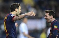 Malaga 1-3 Barcelona: Messi and Cesc expose Malaga&#039;s defensive errors