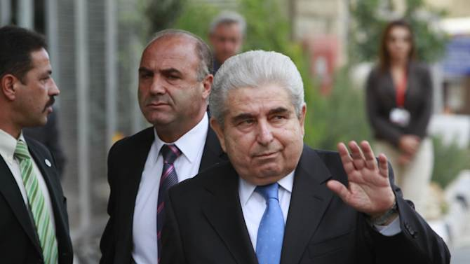Cyprus' President Dimitris Christofias waves to the media as he arrives at the center for the Informal European Integrated Maritime policy in Limassol, Cyprus, Monday, Oct. 8, 2012. (AP Photo/Petros Karadjias)