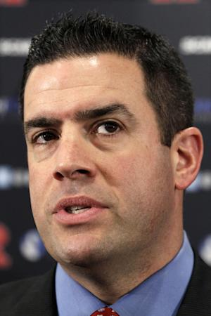 FILE - In this Jan. 31, 2012 file photo, Rutgers Athletic Director Tim Pernetti answers a question in Piscataway, N.J.  Some Rutgers alumni say Pernetti should be dismissed over his handling of men's basketball coach Mike Rice's behavior and some are questioning what university President Robert Barchi knew, and when. (AP Photo/Mel Evans)