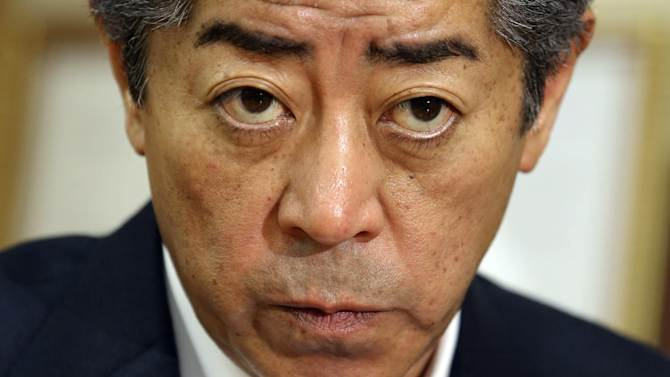 """In this June 30, 2014 photo, Japanese lawmaker and chairman of the ruling Liberal Democratic Party's Research Commission on Security, Takeshi Iwaya listens to a question during an interview in Tokyo. """"In the long run, I think we should put a large security umbrella over the entire Asia-Pacific region, like the one in Europe. That's the direction we seek under the slogan that the Abe administration promotes: proactive contribution to peace based on international cooperation."""" Iwaya replied to The Associated Press about where Japan's military is headed and why it is such a sensitive issue. (AP Photo/Koji Sasahara)"""