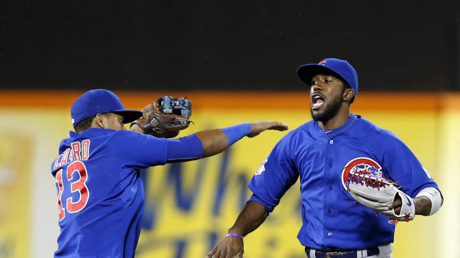 Chicago Cubs shortstop Starlin Castro (13) and Chicago Cubs center fielder Dexter Fowler (24) celebrate after the Cubs 1-0 shutout of the New York Mets in a baseball game in New York, Tuesday, June 30, 2015. (AP Photo/Kathy Willens)