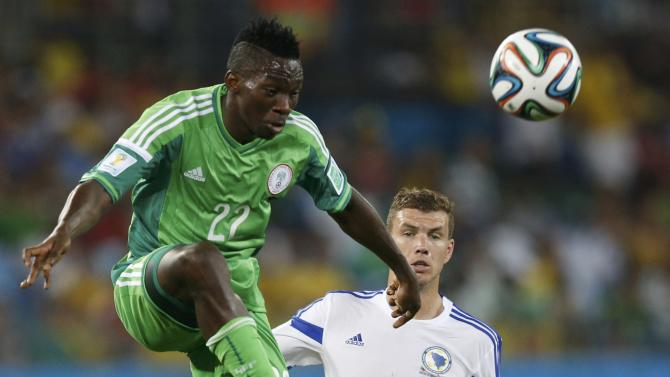 Nigeria's Omeruo kicks the ball infront of Bosnia's Dzeko during their 2014 World Cup Group F soccer match at the Pantanal arena in Cuiaba
